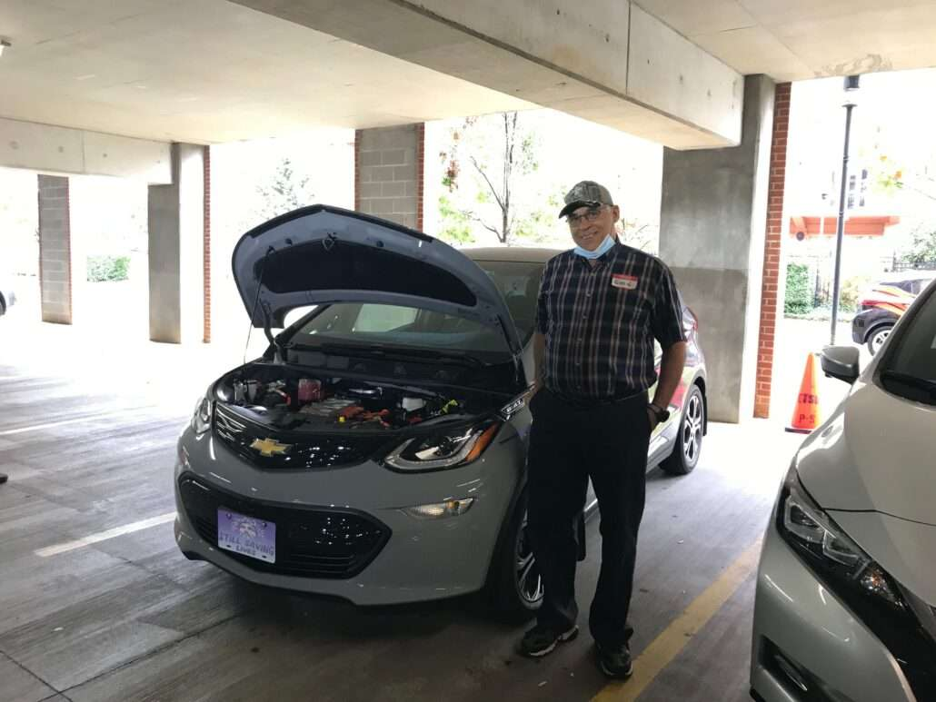 Johnson City Leadership event next to his Chevrolet Bolt