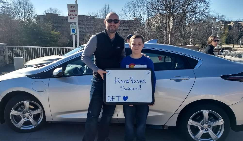 """Ride and Drive, man and child holding sign in front of Chevrolet Volt: 'Knox Vegas Sweet! DET"""""""